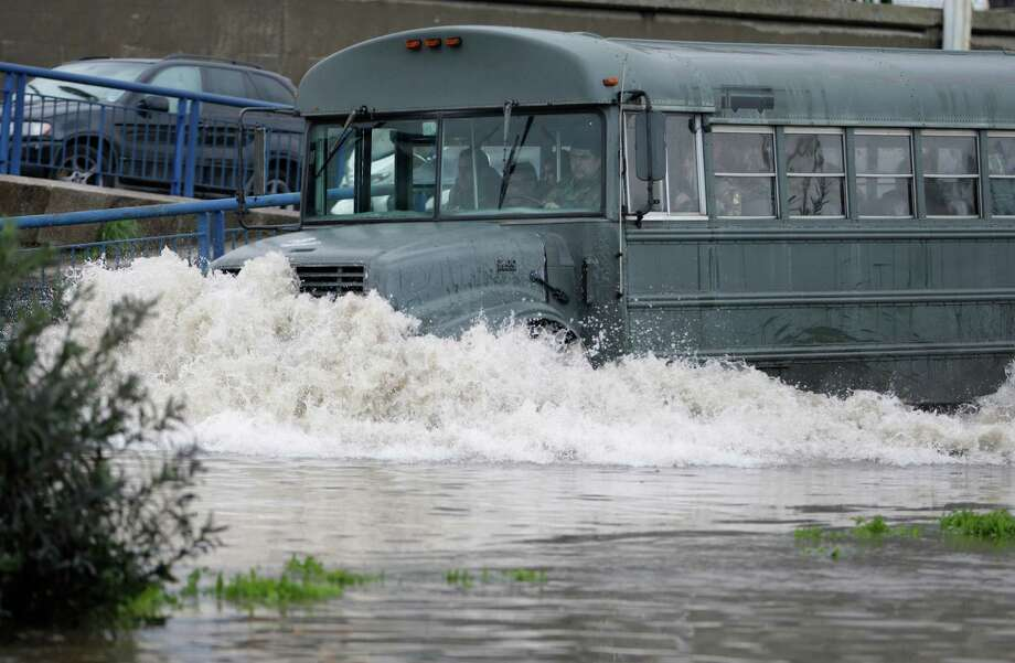 A bus carrying Lebanese army soldiers make its way through a flooded road, in Beirut, Lebanon, on Monday. Lebanon has been hit with a snow storm that has blocked roads in the mountains and brought heavy rain showers to the capital Beirut and other coastal areas since Sunday. Photo: AP