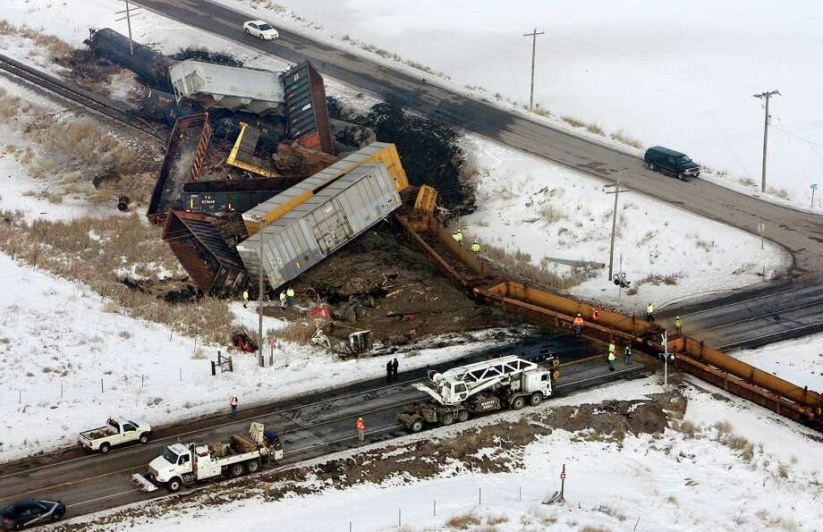 Officials investigate at the scene of a train derailment near Dayton, Idaho, on Wednesday. A dump truck collided with a freight train at a foggy crossing in southeastern Idaho, killing the truck's driver. Photo: AP