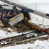 Officials investigate at the scene of a train derailment near Dayton, Idaho, on Wednesday. A dump truck collided with a freight train at a foggy crossing in southeastern Idaho, killing the truck's driver.