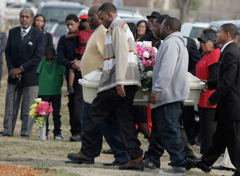 Pallbearers carry the small coffin holding six-year-old Tahlia Johnson on her way to her burial Friday in Dallas. According to Dallas health officials, Thalia's death on Tuesday was caused by the flu.  State health officials say cases have been reported in more than half of Texas, and the intensity of flu-like symptoms is high. Photo: AP