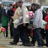 Pallbearers carry the small coffin holding six-year-old Tahlia Johnson on her way to her burial Friday in Dallas. According to Dallas health officials, Thalia's death on Tuesday was caused by the flu.  State health officials say cases have been reported in more than half of Texas, and the intensity of flu-like symptoms is high.
