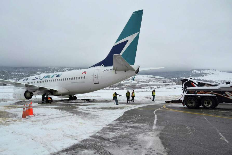 A WestJet Boeing 737-700 aircraft ended up in the mud off an apron next to the Kelowna International