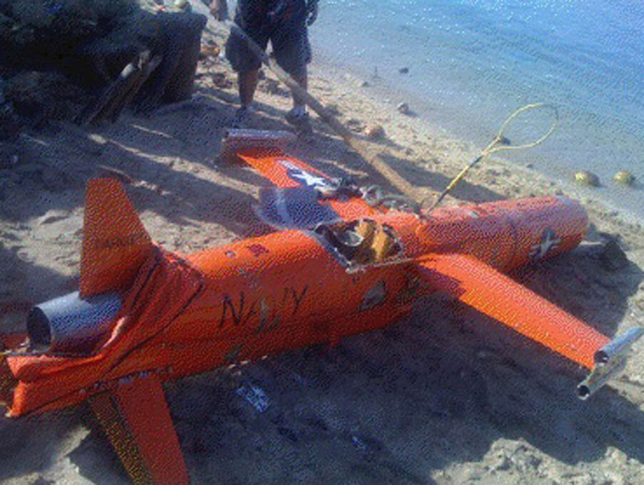 """Naval Forces Southern Luzon brought ashore a suspected American drone off Masbate Island in Central Philippines on Sunday. Philippine Navy officer Capt. Jason Rommel Galang said the 10-foot orange BQM-74e drone marked """"Navy"""" was found by a Filipino diver and fishermen off Ticao island in the island province of Masbate and has been turned over to local navy authorities. It's not clear why the drone ended up off Masbate, according to Galang. (AP Photo/Philippine Navy Southern Luzon) Photo: AP"""