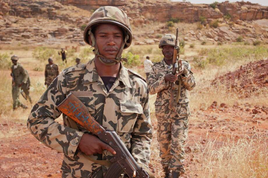 "Soldiers from a Malian army special unit carry their weapons following a training exercise in the Barbe military zone, in Mopti, Mali, in November.  Secretary-General Ban Ki-moon said Friday that France, Senegal and Nigeria have responded to an appeal from Mali's President Dioncounda Traore for help to counter an offensive by al-Qaida-linked militants who control the northern half of the country and are heading south. The U.N. chief said that assisting the Malian defense forces push back against the Islamist armed groups is ""very important."" Photo: AP"