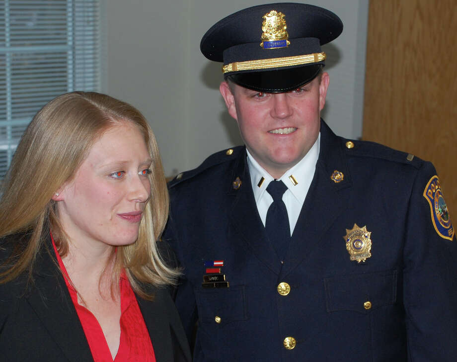 Police Sgt. Jillian Cabana and Lieut. Eric Woods were sworn in to their new ranks Friday by First Selectman Gordon Joseloff at Westport Police Department headquarters.  Westport CT 1/11/13 Photo: Jarret Liotta / Westport News contributed