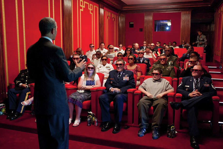 May 25, 2012The President was welcoming service members and their families to a screening of 'Men in Black 3' in the White House Family Theater. The movie was being presented in 3D, so the President jokingly asked them to try on their 3D glasses while he was speaking to them. (Official White House Photo by Pete Souza)