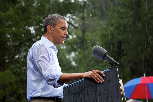 July 14, 2012The President delivers remarks in the pouring rain at a campaign event in Glen Allen, Va. He was supposed to do a series of press interviews inside before his speech, but since people had been waiting for hours in the rain he did his remarks as soon as he arrived at the site so people could go home to dry off . (Official White House Photo by Pete Souza)