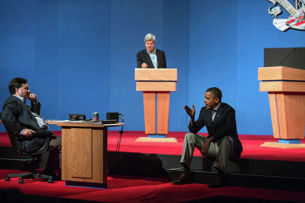 Oct. 2, 2012The President talks with Ron Klain during debate preparations in Henderson, Nev. Sen. John Kerry, D-Mass., background, played the role of Gov. Mitt Romney during the prep sessions. (Official White House Photo by Pete Souza)