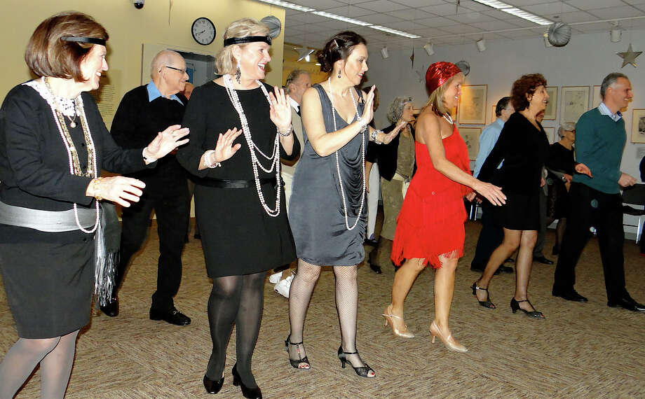 Appropriately costumed dancers try out steps from '20s Jazz Age dances at a WestportREADS program Friday night at the Westport Public Library.  WESTPORT NEWS CT /11/13 Photo: Mike Lauterborn / Westport News