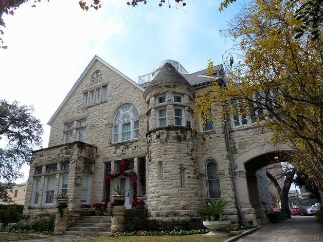 The Maverick-Carter House, tucked away amid offices, churches and Municipal Auditorium, is one of the few residences left downtown that was built in the 19th century. Read More Photo: Billy Calzada, San Antonio Express News / San Antonio Express News