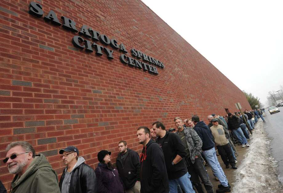 A line block long outside the Saratoga Springs City Center to enter the Saratoga Springs gun show on Saturday Jan. 12,2013 in Saratoga Springs, N.Y. (Michael P. Farrell/Times Union) Photo: Michael P. Farrell