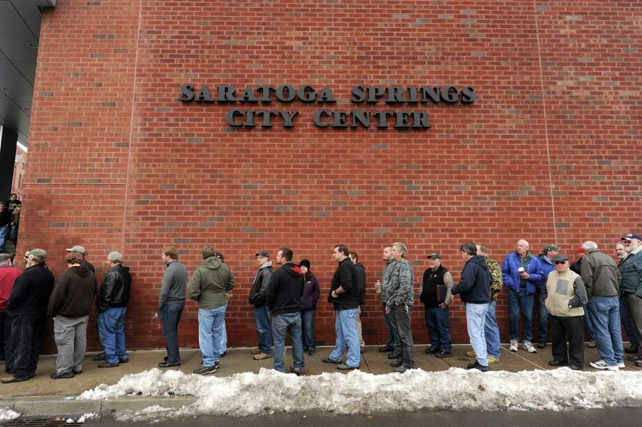 A line blocks long outside the Saratoga Springs City Center to enter the Saratoga Springs gun show on Saturday Jan. 12,2013 in Saratoga Springs, N.Y. (Michael P. Farrell/Times Union) Photo: Michael P. Farrell