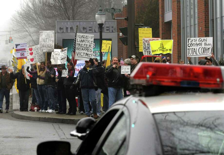 Pro gun rights supporters rally outside the Saratoga Springs City Center during the Saratoga Springs gun show on Saturday Jan. 12,2013 in Saratoga Springs, N.Y. (Michael P. Farrell/Times Union) Photo: Michael P. Farrell