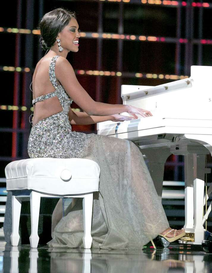 "This photo courtesy Miss America Organization shows Miss North Dakota Rosie Sauvageau took top honors Thursday, Jan. 10, 2013, after her piano and vocal rendition of ""To Make You Feel My Love."" The 24-year-old from Fargo, N.D., will take home a $2,000 Amway scholarship from the competition at Planet Hollywood resort in Las Vegas. (AP Photo/Miss America Organization) Photo: HOEP"