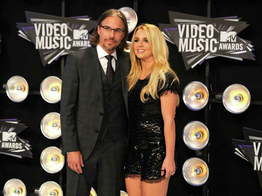FILE - In this Aug. 28, 2011 file photo, Jason Trawick and Britney Spears arrive at the MTV Video Music Awards in Los Angeles.  A judge says Spears' one-time fiance Jason Trawick has resigned as her co-conservator on Friday Jan. 11, 2013. (AP Photo/Chris Pizzello, file) Photo: Chris Pizzello