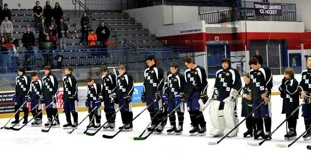 Members of the Newtown High School Ice Hockey team observe 26 seconds of silence honoring the victims of the Sandy Hook Elemantry School tragedy. They were at the Danbury arena for a special Newtown hockey game honoring the victims and first responders Saturday, Jan. 12, 2013. Photo: Michael Duffy / The News-Times