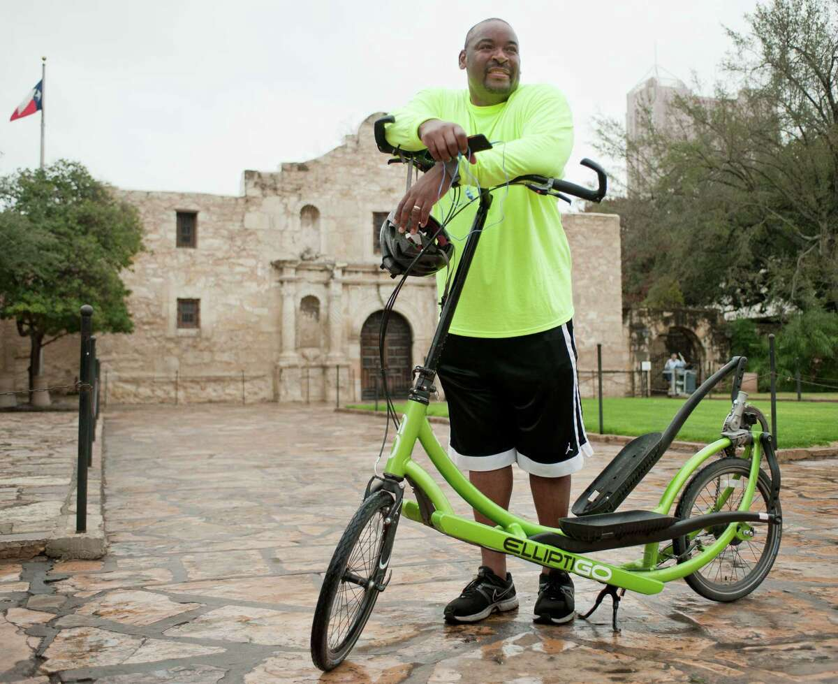 Derrick Boles prepares to resume his 1,892-mile journey on an elliptical bicycle, Saturday, Jan. 12, 2013, at the Alamo in San Antonio. Partway through an 1,892-mile bike ride across America, Derrick Boles paused Saturday morning in front of the Alamo. The president of a community development organization based in Nampa, Idaho, Boles is on a one-man campaign to awaken America from its apathy. His trip, which began in San Diego, will end in New Orleans during Superbowl weekend.