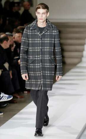 A model wears a creation of Jil Sander men's Fall-Winter 2013-14 collection, part of the Milan Fashion Week, unveiled in Milan, Italy, Saturday, Jan. 12, 2013. (AP Photo/Antonio Calanni) Photo: Antonio Calanni / AP