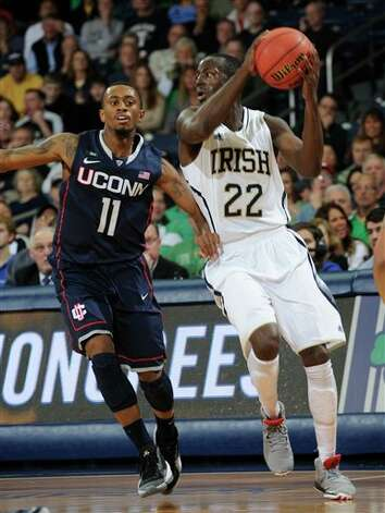 Notre Dame guard Jerian Grant, right, throws a pass around Connecticut guard Ryan Boatright during the first half of an NCAA college basketball game, Saturday, Jan. 12, 2013, in South Bend, Ind. (AP Photo/Joe Raymond) Photo: Joe Raymond, ASSOCIATED PRESS / ASSOCIATED PRESS