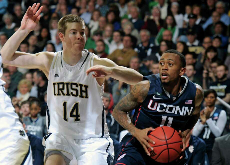 Connecticut guard Ryan Boatright drives the lane as Notre Dame guard Scott Martin defends in the second half of an NCAA college basketball game on Saturday, Jan. 12, 2013, in South Bend, Ind. Connecticut won 65-58. (AP Photo/Joe Raymond) Photo: Joe Raymond, Associated Press / Associated Press