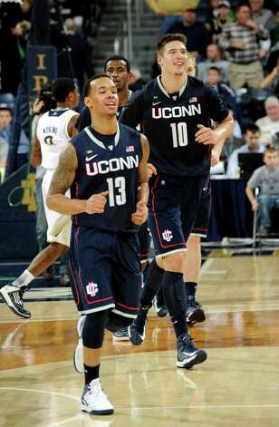 Connecticut players Shabazz Napier, left, and Tyler Olander walk off the court following their 65-58 victory over Notre Dame in an NCAA college basketball game Saturday, Jan. 12, 2013, in South Bend, Ind. Napier scored 19 points and Olander 16 points. (AP Photo/Joe Raymond) Photo: Joe Raymond, ASSOCIATED PRESS / Associated Press