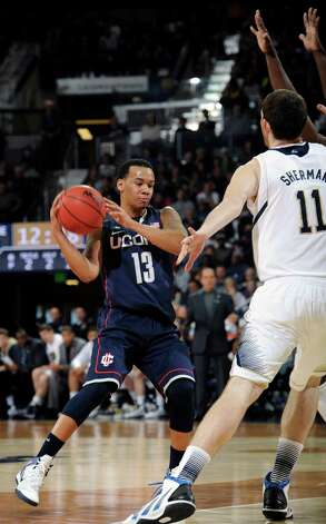 Connecticut guard Shabazz Napier drives the lane as Notre Dame forward Garrick Sherman defends in the second half of an NCAA college basketball game on Saturday, Jan. 12, 2013, in South Bend, Ind. Connecticut won 65-58 as Napier lead all scorers with 19 points. (AP Photo/Joe Raymond) Photo: Joe Raymond, Associated Press / Associated Press