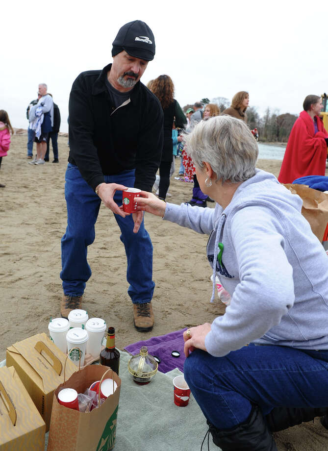 Dan Liberati, of Danbury, gets some hot chocolate while at a polar plunge which was held to benefit two charities named for two victims of the Newtown tragedy, at Southport Beach in Southport, Conn. on Saturday January 12, 2013. Money raised goes to the Grace McDonnell Memorial Fund and the Glenn Atkinson Memorial Scholarship Fund. Photo: Christian Abraham / Connecticut Post