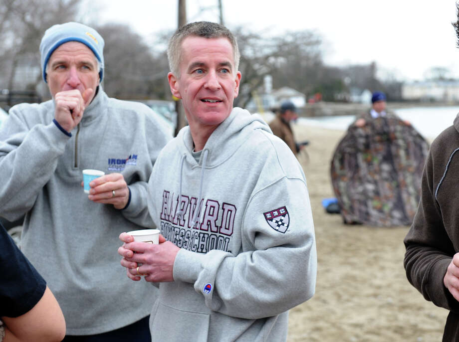 Chris McDonnell, whose daughter Grace was a victim in the Newtown shootings, takes part in a polar plunge which was held to benefit two charities named for two victims of the Newtown tragedy, at Southport Beach in Southport, Conn. on Saturday January 12, 2013. Money raised goes to the Grace McDonnell Memorial Fund and the Glenn Atkinson Memorial Scholarship Fund. Photo: Christian Abraham / Connecticut Post