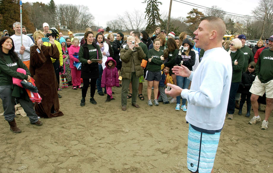 Organizer Eric Hodska thanks participants for coming to a polar plunge which was held to benefit two charities named for two victims of the Newtown tragedy, at Southport Beach in Southport, Conn. on Saturday January 12, 2013. Money raised goes to the Grace McDonnell Memorial Fund and the Glenn Atkinson Memorial Scholarship Fund. Photo: Christian Abraham / Connecticut Post