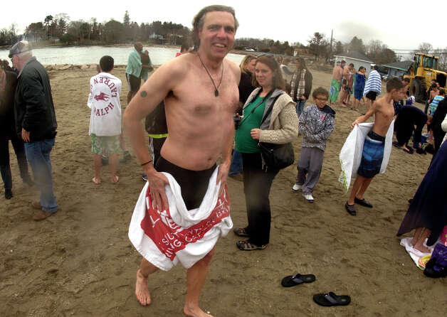 Rick Magee, of Bethel, exits the water after taking part in a polar plunge which was held to benefit two charities named for two victims of the Newtown tragedy, at Southport Beach in Southport, Conn. on Saturday January 12, 2013. Money raised goes to the Grace McDonnell Memorial Fund and the Glenn Atkinson Memorial Scholarship Fund. Photo: Christian Abraham / Connecticut Post