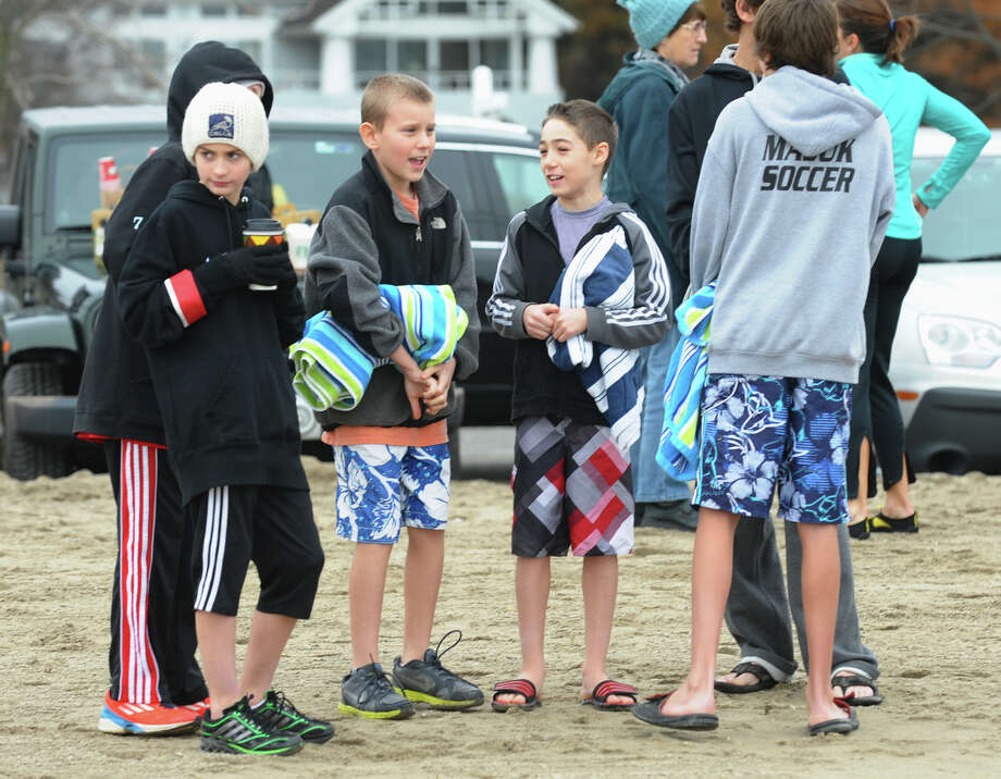 A polar plunge was held to benefit two charities named for two victims of the Newtown tragedy, at Southport Beach in Southport, Conn. on Saturday January 12, 2013. Money raised goes to the Grace McDonnell Memorial Fund and the Glenn Atkinson Memorial Scholarship Fund. Photo: Christian Abraham / Connecticut Post