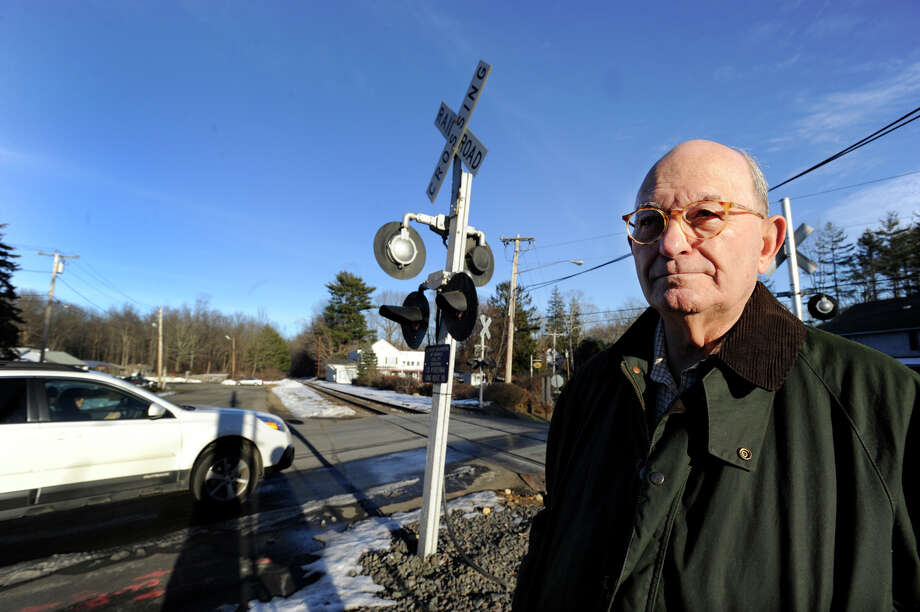 Vito Ninivaggi, 80, has been advocating for the installation of protective gates at the Long Ridge Road rail crossing in West Redding, the scene of a fatal car accident on Dec. 30.  He is photographed at the crossing Thursday, January 10, 2013. Photo: Carol Kaliff / The News-Times