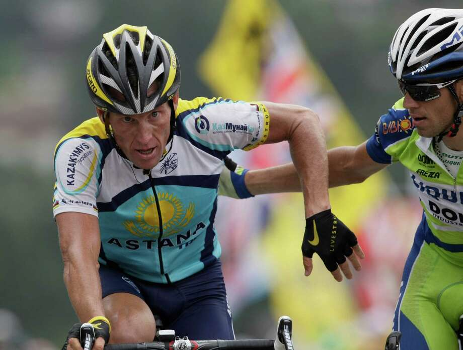 Vincenzo Nibali of Italy, right, and American seven-time Tour de France winner Lance Armstrong, left, exchange thanks as they crosses the finish line to win the 17th stage of the Tour de France cycling race over 169.5 kilometers (105.3 miles) with start in Bourg-Saint-Maurice and finish in Le Grand-Bornand, Alps region, France, Wednesday July 22, 2009. Both riders broke away from Armstrong's main contender for the second place overall, Bradley Wiggins of Britain. (AP Photo/Bas Czerwinski) Photo: BAS CZERWINSKI, Associated Press / AP