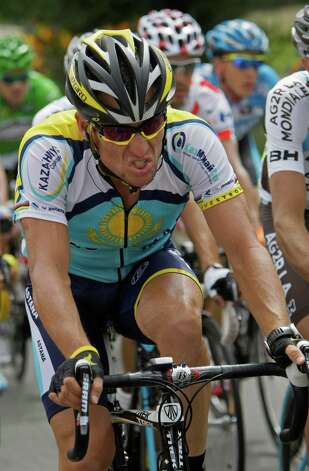 American seven-time Tour de France winner Lance Armstrong strains as he rides in the pack during 11th stage of the Tour de France cycling race over 192 kilometers (119.3 miles) with start in Vatan and finish in Saint-Fargeau, central France, Wednesday July 15, 2009. (AP Photo/Bas Czerwinski) Photo: BAS CZERWINSKI, Associated Press / AP