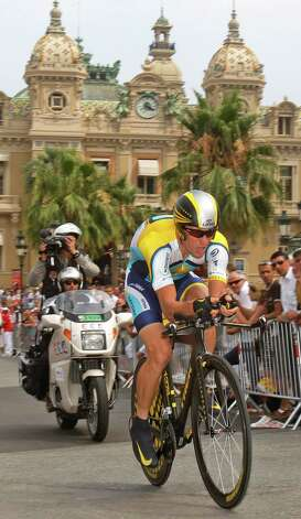 American seven-time Tour de France winner Lance Armstrong strains as he passes Monaco's Casino during the first stage of the Tour de France cycling race, an individual time trial of 15.5 kilometers (9.63 miles) with start and finish in Moncao, Saturday July 4, 2009. (AP Photo/Christophe Ena) Photo: CHRISTOPHE ENA, Associated Press / AP