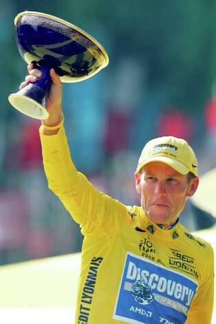Lance Armstrong holds the winner's trophy after winning his seventh straight Tour de France cycling race July 24, 2005, during ceremonies on the Champs-Elysees avenue in Paris.  (AP Photo/Peter Dejong) Photo: PETER DEJONG, Associated Press / AP