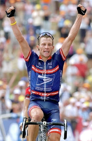 US Postal Service team leader Lance Armstrong, of Austin, Texas, reacts as he crosses the finish line to win, ahead of Italian Ivan Basso, unseen, the 13th stage of the Tour de France cycling race between Lannemezan, southwestern France, and Plateau de Beille, Pyrenees mountains, Saturday, July 17, 2004. (AP Photo/Peter Dejong) Photo: PETER DEJONG, Associated Press / AP