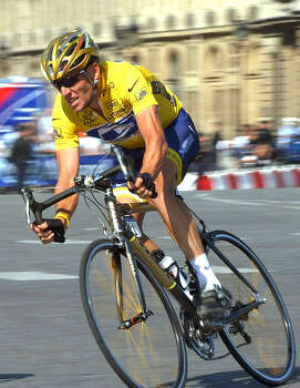 Lance Armstrong, of Austin, Texas, negotiates a curve as he enters Concorde square in Paris during the 20th and last stage of the Tour de France cycling race July 25, 2004 between Montereau, southeast of Paris, and the Champs-Elysees avenue in Paris.   (AP Photo/Peter Dejong) Photo: PETER DEJONG, Associated Press / AP