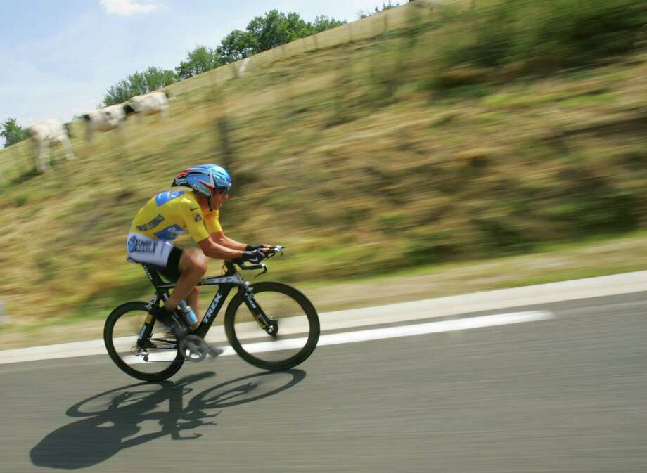 Overall leader Lance Armstrong, of Austin, Texas, pedals during the 20th stage of the Tour de France cycling race, a 55.5-kilometer (34.5-mile) individual time trial looping around north of Saint-Etienne, central France, Saturday, July 23, 2005. Armstrong won the stage. (AP Photo/Christophe Ena) Photo: CHRISTOPHE ENA, Associated Press / AP
