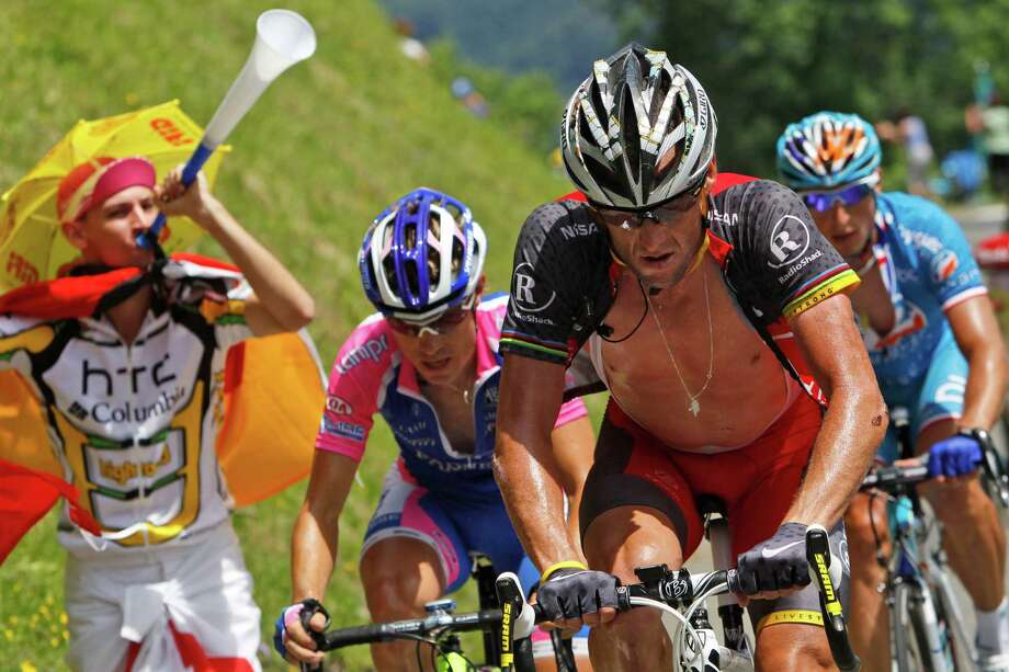 Damiano Cunego of Italy, Lance Armstrong of the US, and stage winner Pierrick Fedrigo of France, left to right, climb towards Tourmalet pass during the 16th stage of the Tour de France cycling race over 199.5 kilometers (124 miles) with start in Bagneres-de-Luchon and finish in Pau, Pyrenees region, France, Tuesday, July 20, 2010. (AP Photo/Christophe Ena) Photo: Christophe Ena, Associated Press / AP