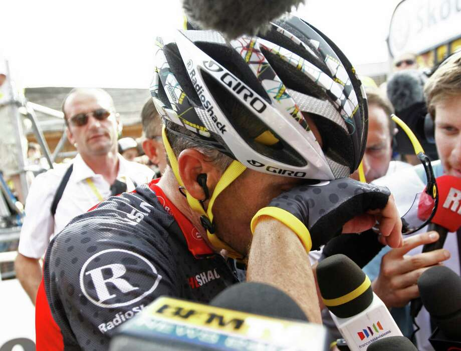 Lance Armstrong of the US reacts after he crosses the finish with a delay following a crash during the eighth stage of the Tour de France cycling race over 189 kilometers (117.4 miles) with start in Station des Rousses, and finish in Morzine-Avoriaz, France, Sunday, July 11, 2010. Armstrong now ranks 39th with a delay of more than 13 minutes on new overall leader Cadel Evans of Australia. (AP Photo/Nicolai Dumitrache) Photo: NIcolai Dumitrache, Associated Press / AP