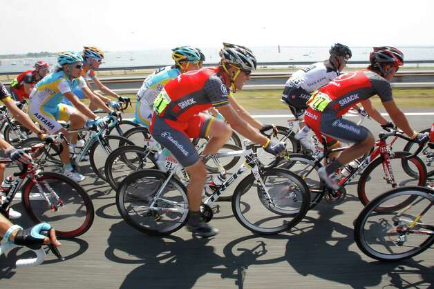 Lance Armstrong of the US, center, rides in the pack during the first stage of the Tour de France cycling race over 223.5 kilometers (139 miles) with start in Rotterdam, Netherlands and finish in Brussels, Belgium, Sunday July 4, 2010. (AP Photo/Bas Czerwinski) Photo: Bas Czerwinski, Associated Press / AP