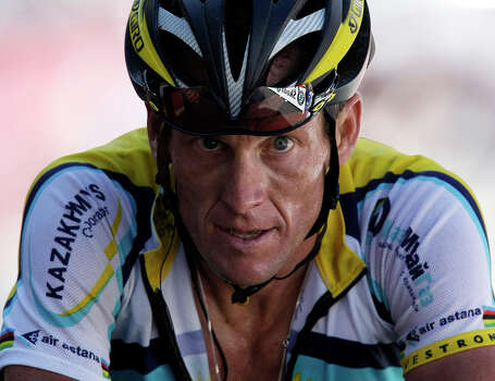 American seven-time Tour de France winner Lance Armstrong crosses the finish line July 19, 2009 during 15th stage of the Tour de France cycling race over 207.5 kilometers (129 miles) which started in Pontarlier, France and finished in Verbier, Switzerland.   (AP Photo/Laurent Rebours) Photo: Associated Press / AP2009