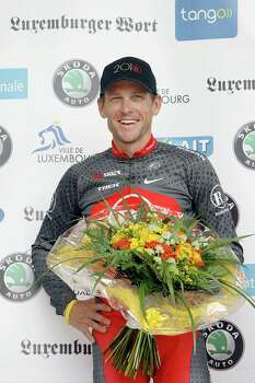 Lance Armstrong of the Radioshack team smiles as he stands on the podium after placing third general in the Tour de Luxembourg in Luxembourg, Sunday June 6, 2010. (AP Photo/Geert Vanden Wijngaert) Photo: Geert Vanden Wijngaert, Associated Press / AP