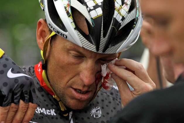 Cyclist Lance Armstrong is tended to after crashing during the fifth stage of the Tour of California cycling race in the outskirts of Visalia, Calif., Thursday, May 20, 2010. (AP Photo/Marcio Jose Sanchez) Photo: Marcio Jose Sanchez, Associated Press / AP2010