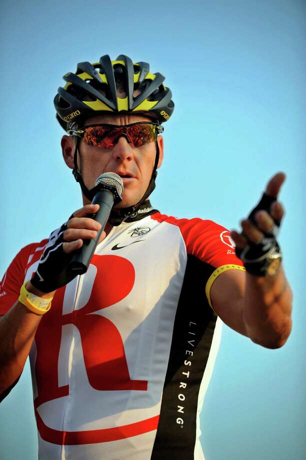Team RadioShack cyclist Lance Armstrong addresses the 1500 cyclists participating in the Harpeth River Ride Saturday, June 11, 2011 in Franklin, Tenn. (AP Photo/The Tennessean, George Walker IV) Photo: George Walker IV, Associated Press / THE TENNESSEAN