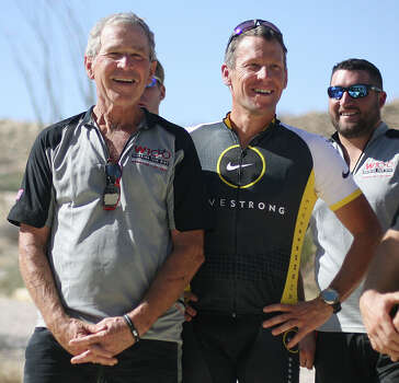 Former President George W. Bush, left, stands next to seven-time Tour de France winner Lance Armstrong, Wednesday, April 27th, 2011 at Big Bend Park, Texas. Bush and Armstrong took part in a 100 kilometer mountain bike ride with the servicemen who lost their limbs in war. (AP Photo/Odessa American, Heather Leiphart) Photo: Heather Leiphart, Associated Press / The Odessa American