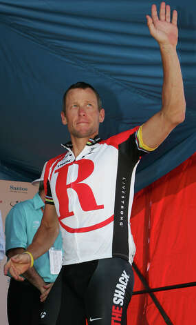American Lance Armstrong, who rides for Team Radio Shack, waves as he walks on stage after the South Australia premier thanked him for his support in the Tour Down Under cycling event at Adelaide, Australia, Sunday, Jan. 23, 2011. (AP Photo/James Knowler) Photo: James Knowler, Associated Press / AP