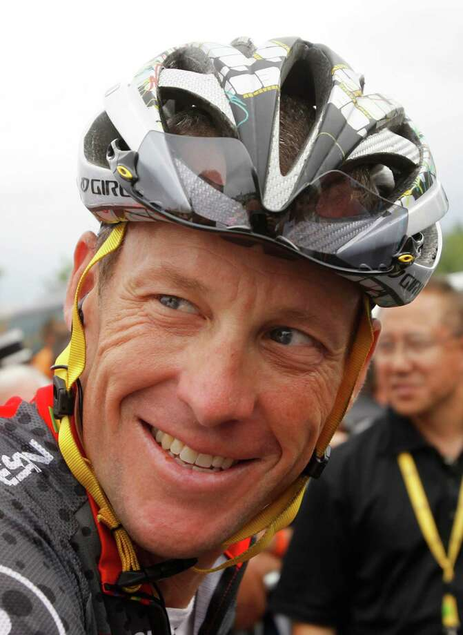 Lance Armstrong smiling prior to the sixth stage of the Tour de France cycling race July 9, 2010, in Montargis, France.  (AP Photo/Bas Czerwinski) Photo: Bas Czerwinski, Associated Press / AP