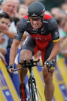 Seven-time Tour de France winner Lance Armstrong strains to take a fourth place July 3, 2010 during the prologue of the Tour de France cycling race in Rotterdam, Netherlands.  (AP Photo/Laurent Rebours) Photo: Laurent Rebours, Associated Press / AP